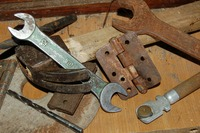 Pile of rusted wrenches and hinges.